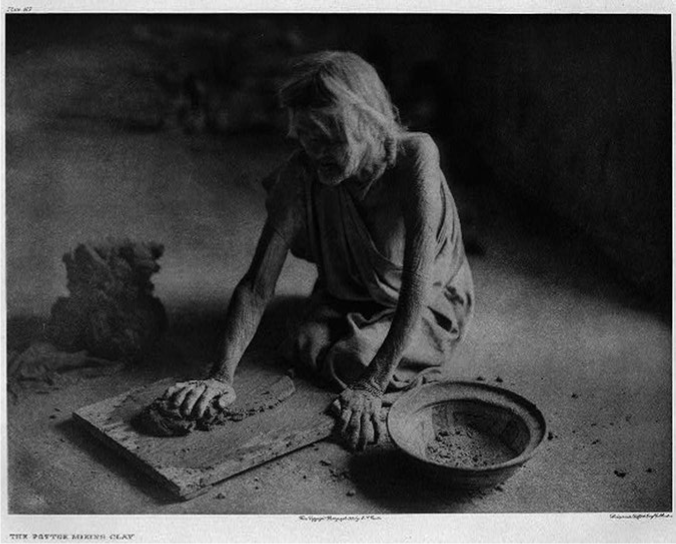 An elderly woman mixing clay for ceramic production in the Puebloan world