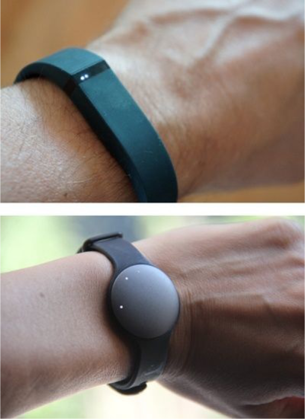 Fitbit Flex (top) and Misfit Shine provide light-based visual feedback on the wearable device