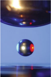 Sample levitated between electrodes and heated by laser [1]