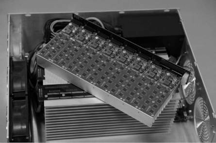 An early ASIC Bitcoin-mining machine from the Avalon Corporation. The small chips arranged in a grid are each custom ASIC chips designed to perform Bitcoin hash operations.