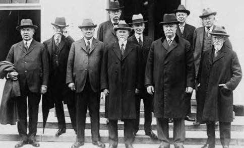The U.S. Circuit Court judges gather for a photo at a conference, accompanied by then-U.S. Supreme Court Justice William Howard Taft (fourth from right) in an undated 1920s photo (Library of Congress).