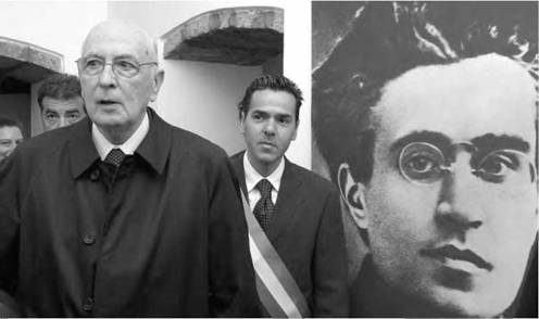 The president of Italy visits Antonio Gramsci museum. Gramsci (whose photo is seen in the background on the right) came up with the idea that a society's dominant class defines the ideology of all classes within that society (AP).